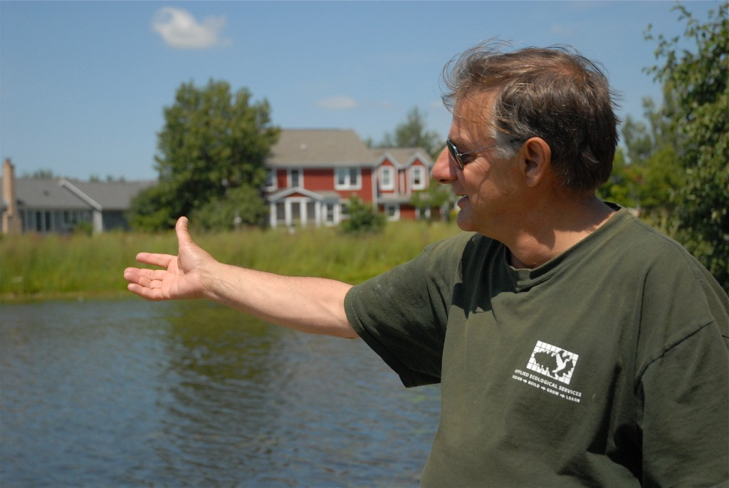 Steve Apfelbaum shows us the lake at Prairie Crossing where the water has been filtered by the native plant landscape and is pure enough to swim in.