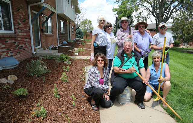 Volunteer residents at Cherry Creek 3, a 250 unit townhome community in Denver, finish relandscaping unit fronts with native and adapted plants.