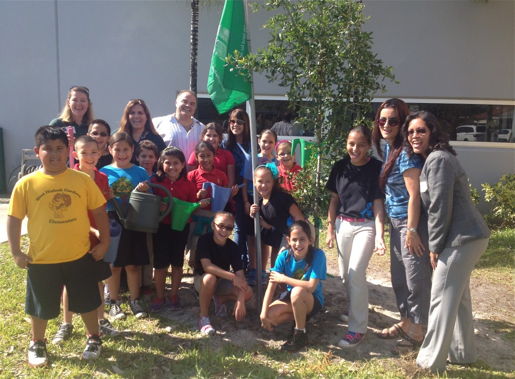 Students at West Hialeah Gardens students plant a tree in an Earth Day observance. photo Catherine B. Zimmerman